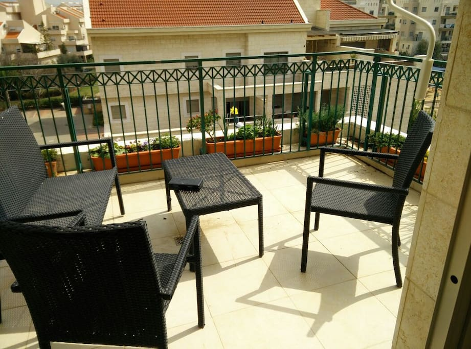 big balcony with chairs BBQ spot. Sink. Fully shaded.