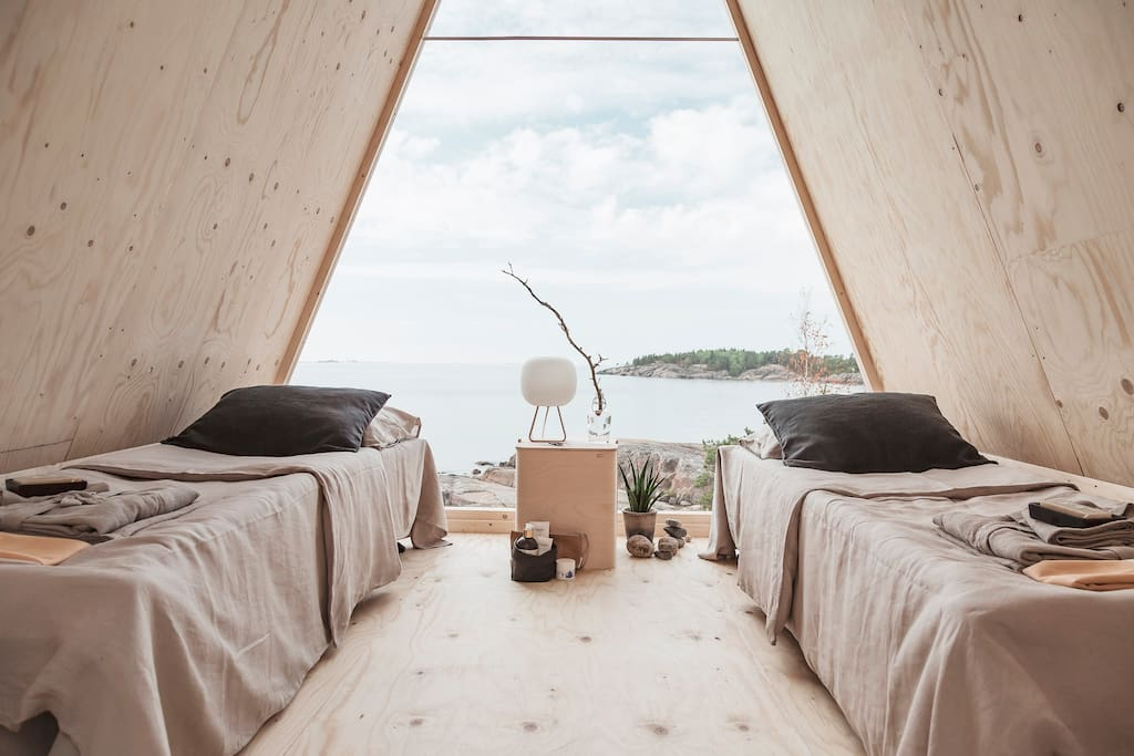 The cabin features two camp beds with a breathtaking view of the archipelago.