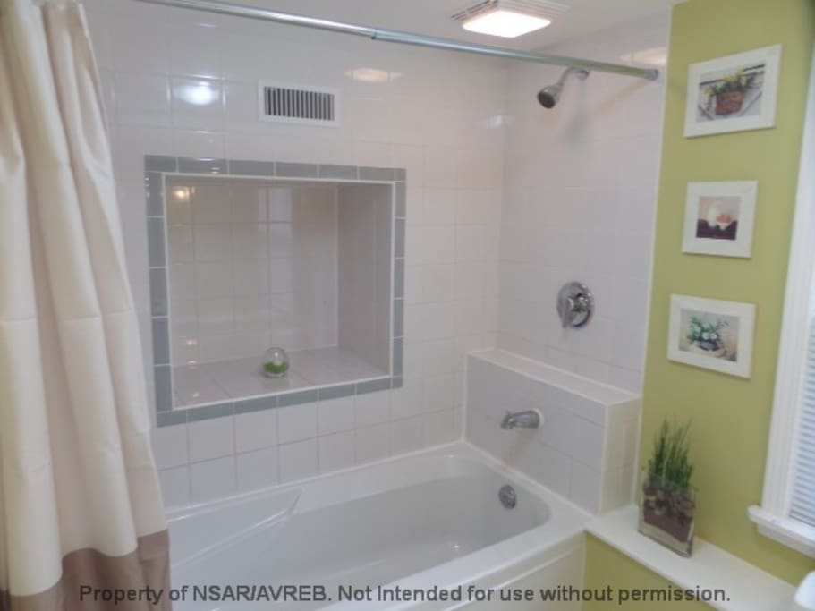 Guest level bathroom with a soaker tub, shower & toilet.