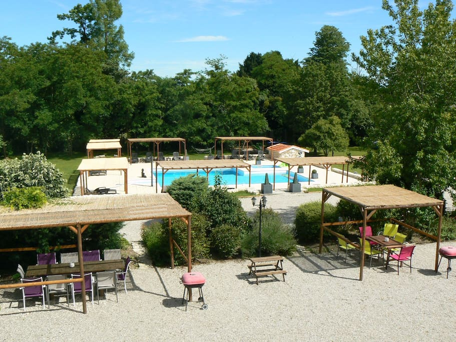 View of pool and outdoor dining area