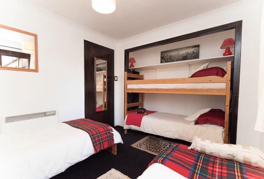 The bedroom is small but very cozy in its tartan colours.