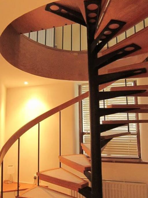 spiral staircase leads to lounge