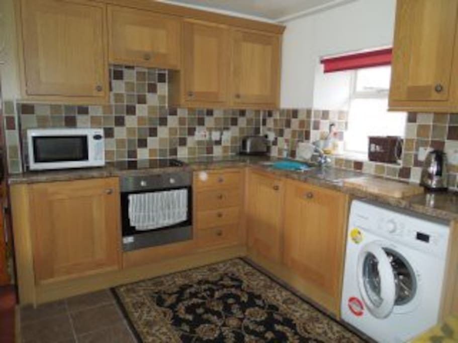 Kitchen With Washing Machine, Dish Washer, Oven, 4 pan Hob, Microwave.