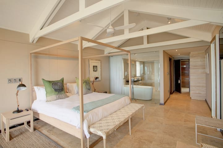 The Honeymoon Suite features a romantic four-poster bed