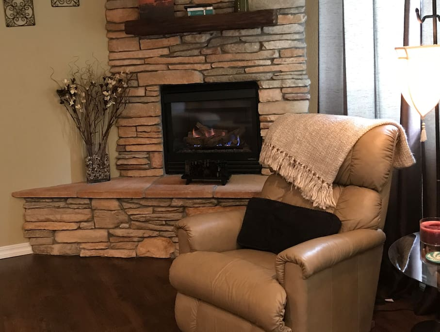 Cozy gas fireplace with blower.