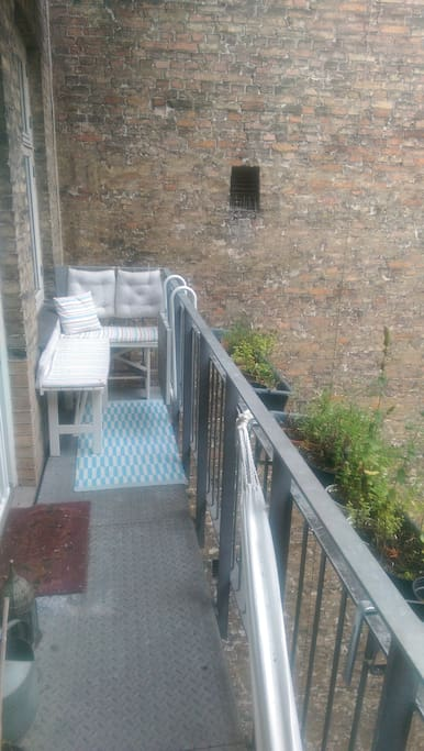 Balcony facing small quiet courtyard. Access from master bedrom. No noise.