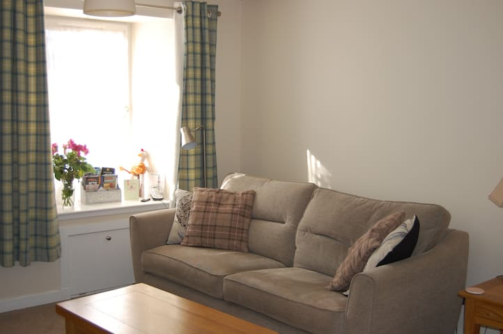 Feel free to share our Sitting room with us.