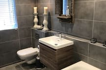 This is the master en-suite bathroom which has a bath with shower mixer, basin and toilet. All branded toiletries are provided.