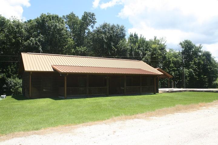 West Sandy Creek Winery Creekside Log Cabin