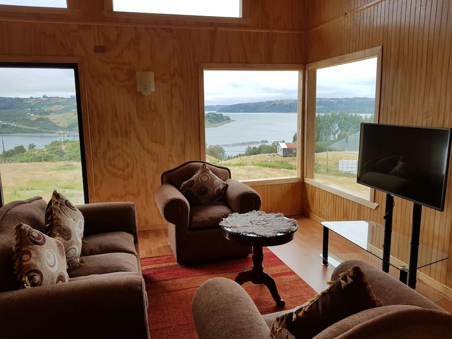 sala de estar y vista a la bahía