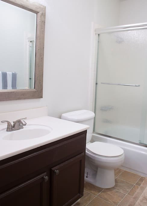 Shared upstairs bathroom with tub and shower