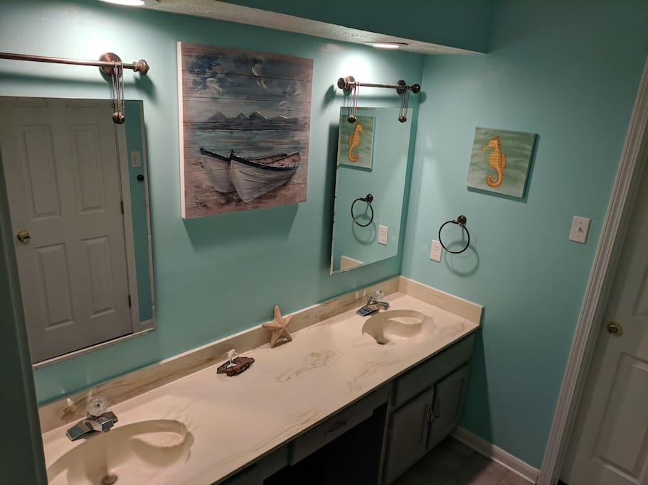 Double sink in a shared bathroom connected to your room.