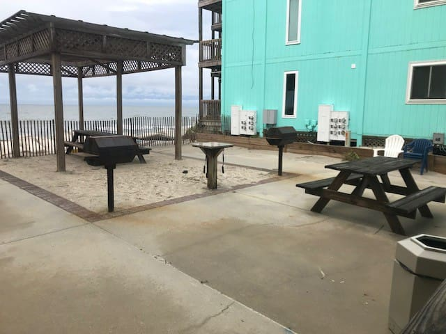 Ocean front Grill area located behind the laundry room