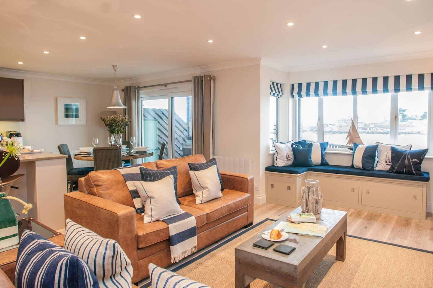 Open plan living room, dining room and window seat overlooking Burgh Island