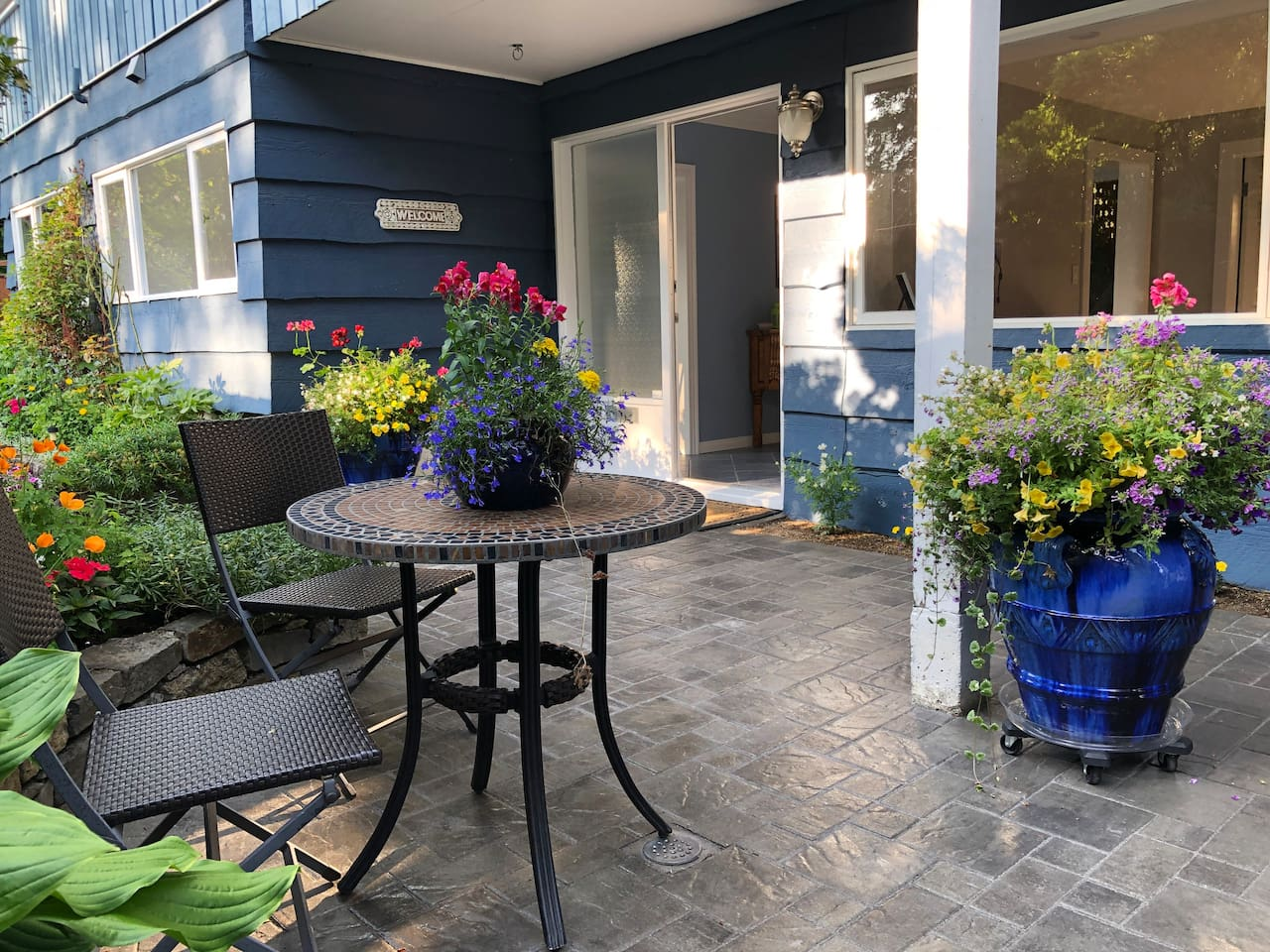 We welcome you!  Your private garden patio, is available May through September weather permitting.