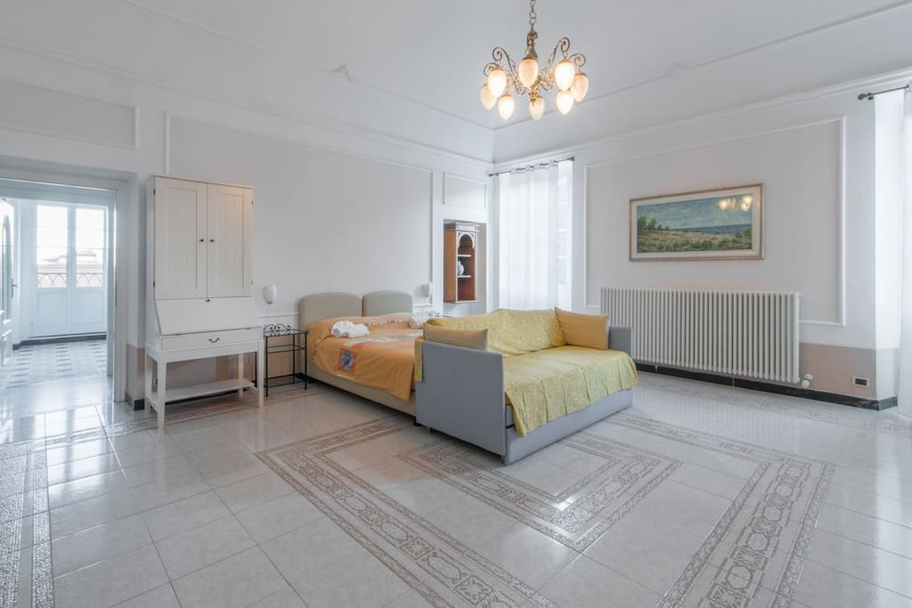 Bright, comfortable and spacious bedroom with double bed and sleeping sofa
