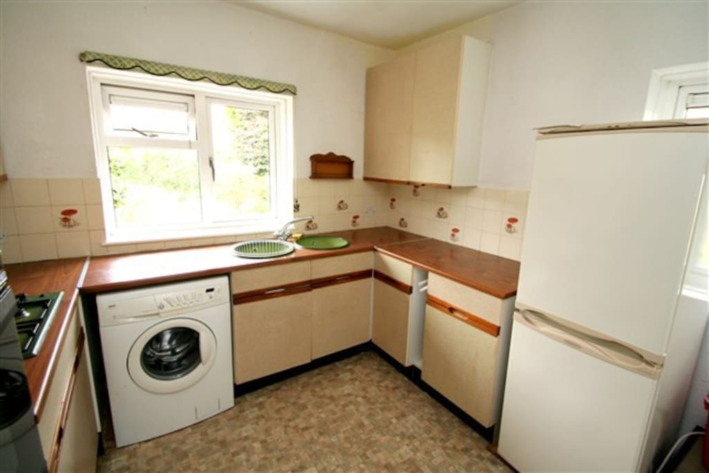 Dated but clean and fully functional kitchen!
