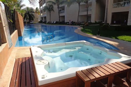 Cozy room, pool and hot tube next to the beach - Puerto Aventuras - Lejlighedskompleks