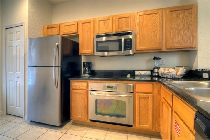 Kitchen- Stove, fridge, Microwave