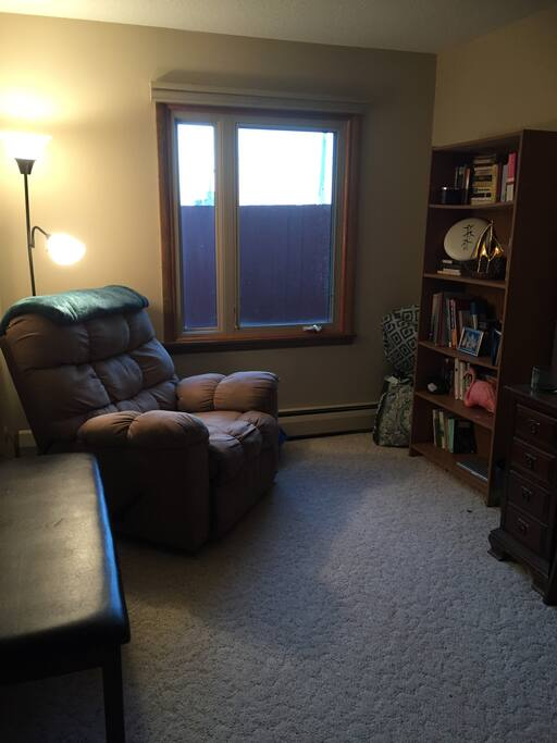 This will be your room. It is set up as a study so you can sit comfortably and relax in the lounge chair or you can use the desk for work. When you are ready, I can help you set up the air mattress. Or, the mattress can be set up upon arrival if you would prefer. There is a full sized mirror on the back of the door.