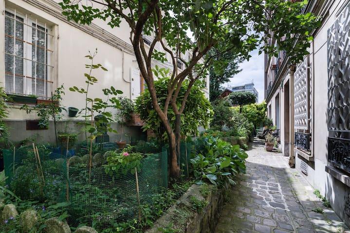 duplex au pied des Buttes Chaumont - Paryż - Apartament