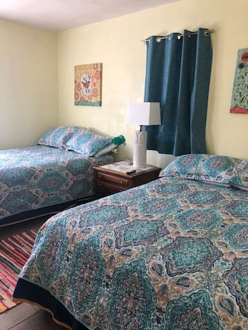 Bedroom with 2 double beds.