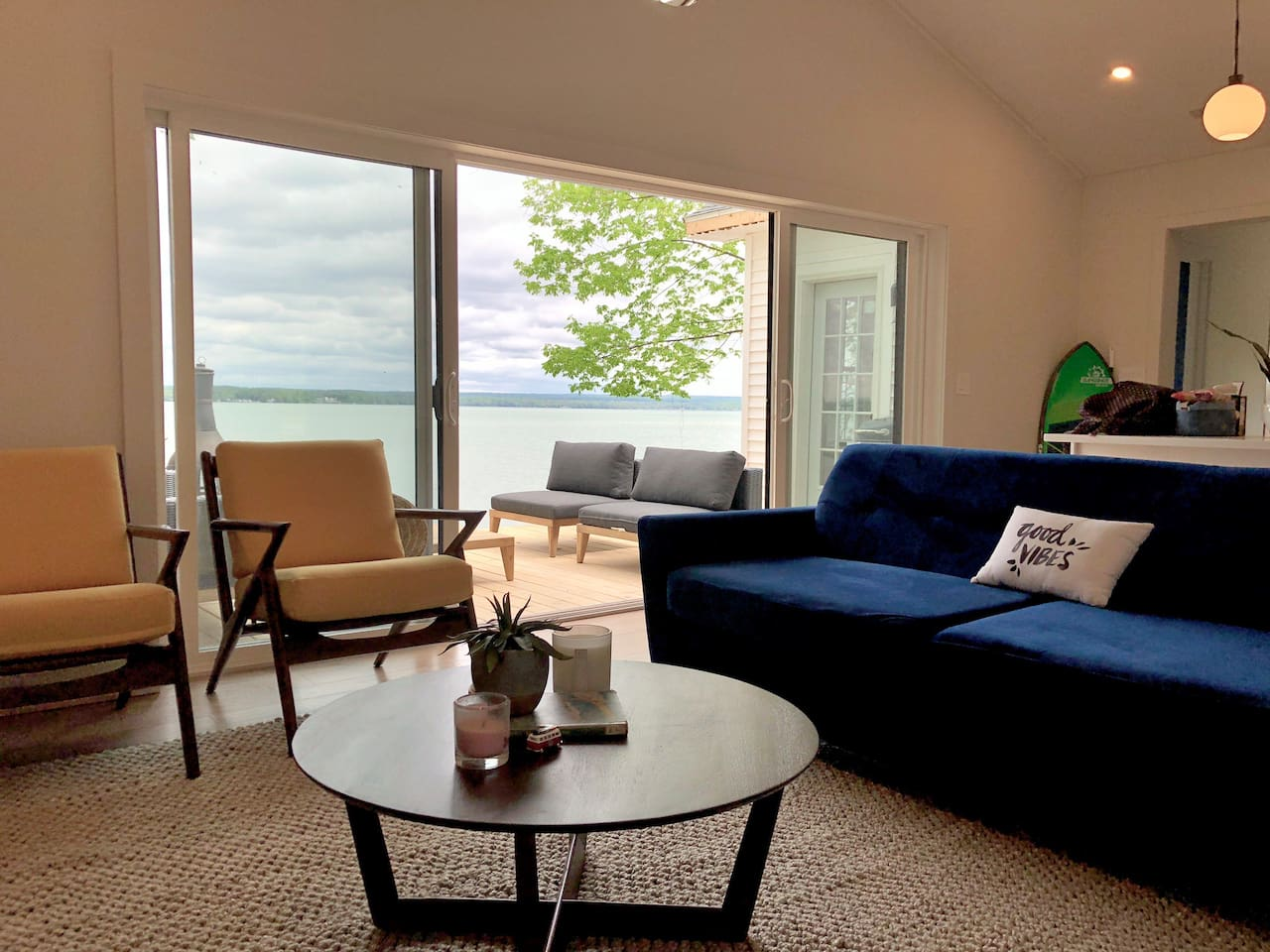 Our living room features a 14 foot sliding door to a 24x14 ft deck.