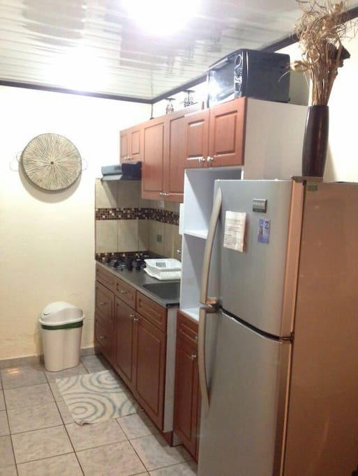 Kitchen / fully equipped with gas range.