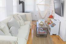 A cozy living room for relaxed down time. Enjoy the game boards, smart TV, hammock chair, toys, and propane fireplace.