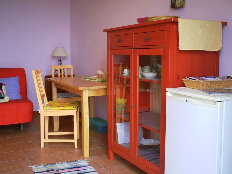 Your own living room/kitchen. The cabinet is equipped with all the cooking utensils you might need.