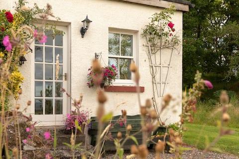 Woodend Cottage   Un escondite acogedor y rústico