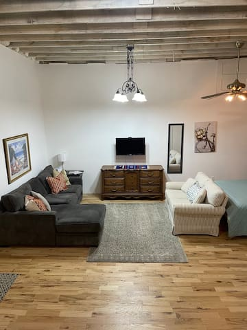 Living area with sectional, loveseat and tv