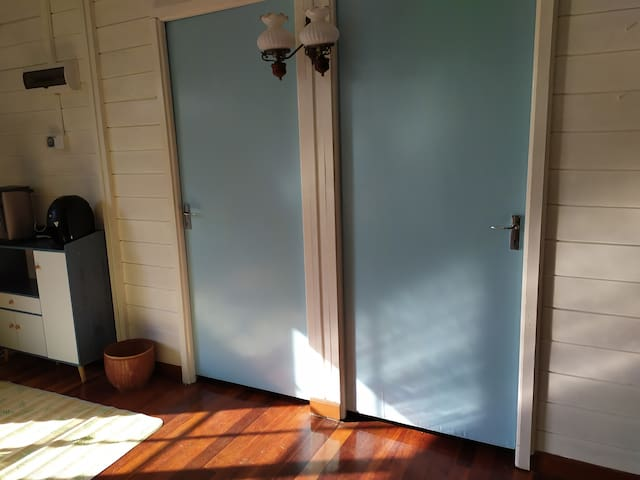 Entrance to both the bedrooms in the wooden chalet