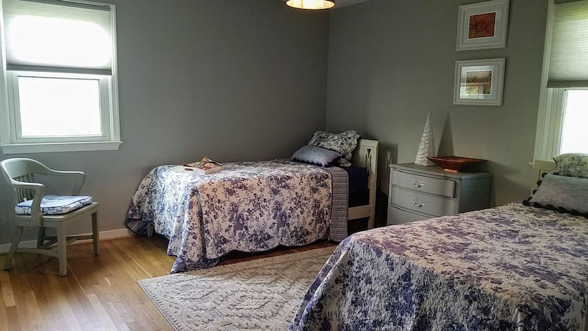Bedroom #2 -Autumn Harvest features a twin bed, full bed, a closet, and drawers.