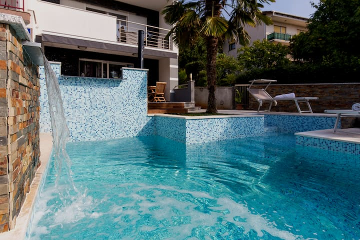 Two Story Apartment With Overflowing Pool-2 pools