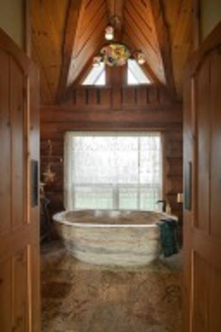 Find your zen in your  private travertine tub