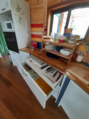 Cutlery drawer is inside the  larger drawer  under the crockery.