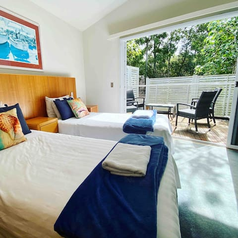 Twin bedroom with secluded balcony