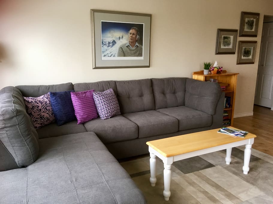 NEW couch Spring 2018. Main living space overlooking Strathcona Park with propane fireplace and access to deck and lounge chairs.