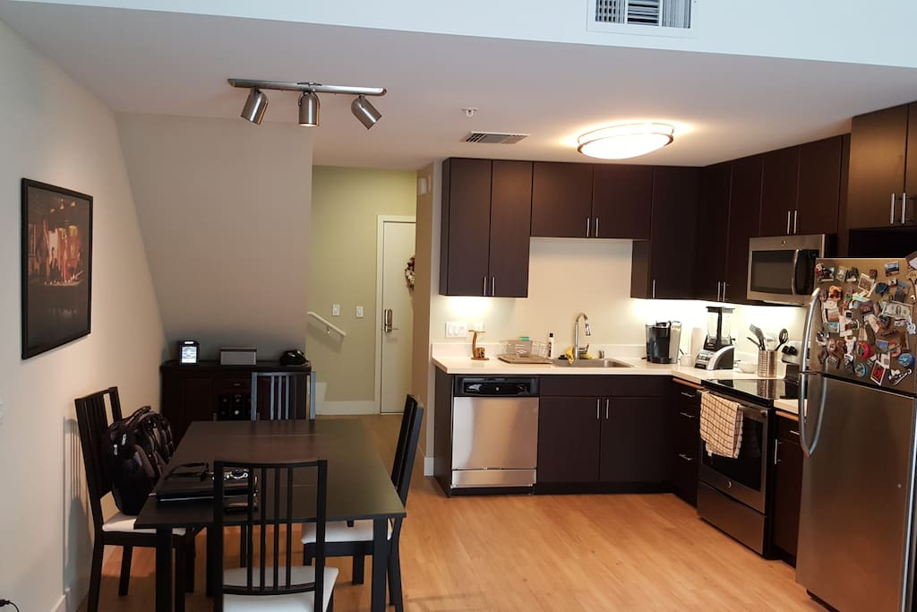 Kitchen with pans, pots, mixer, ice maker, coffee machine, glasses, utensil, plates, etc.