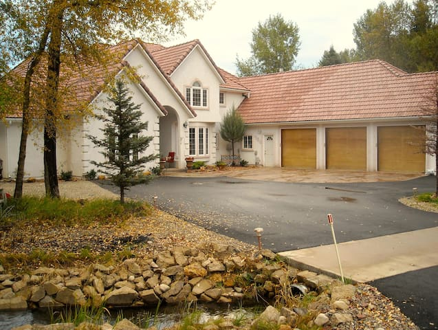 Master Suite with private entrance on golf course