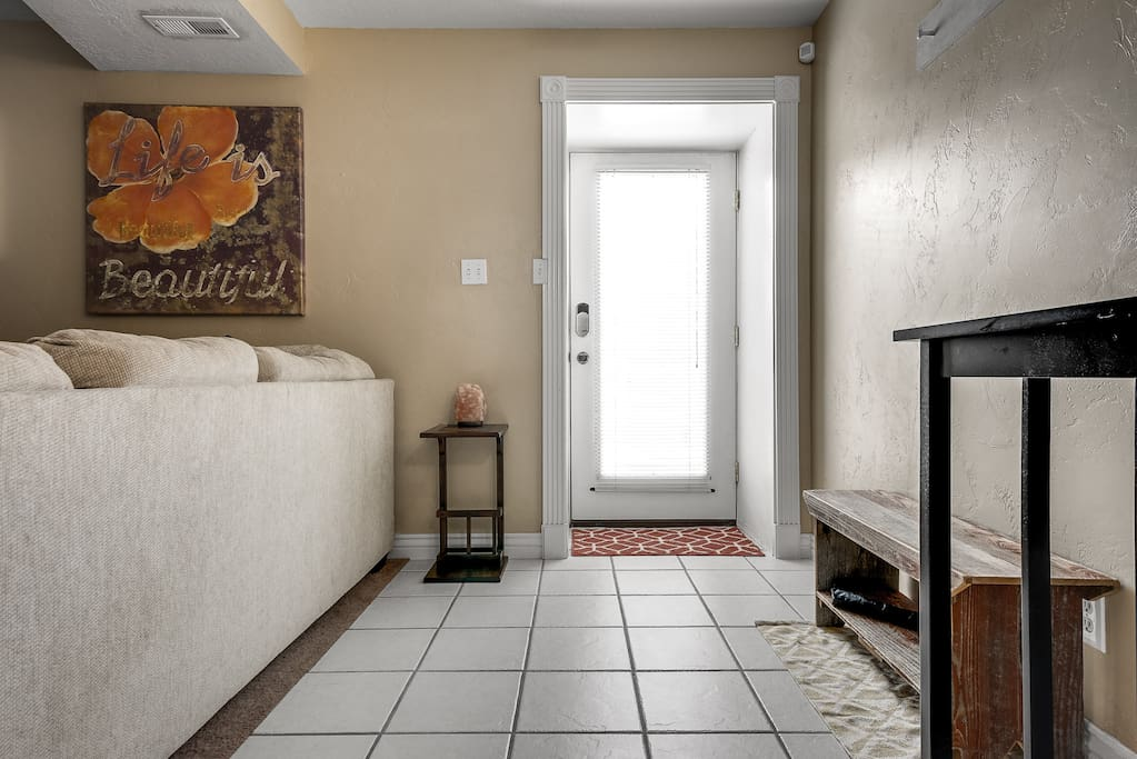 Brightly lit entryway provides natural lighting throughout the unit.