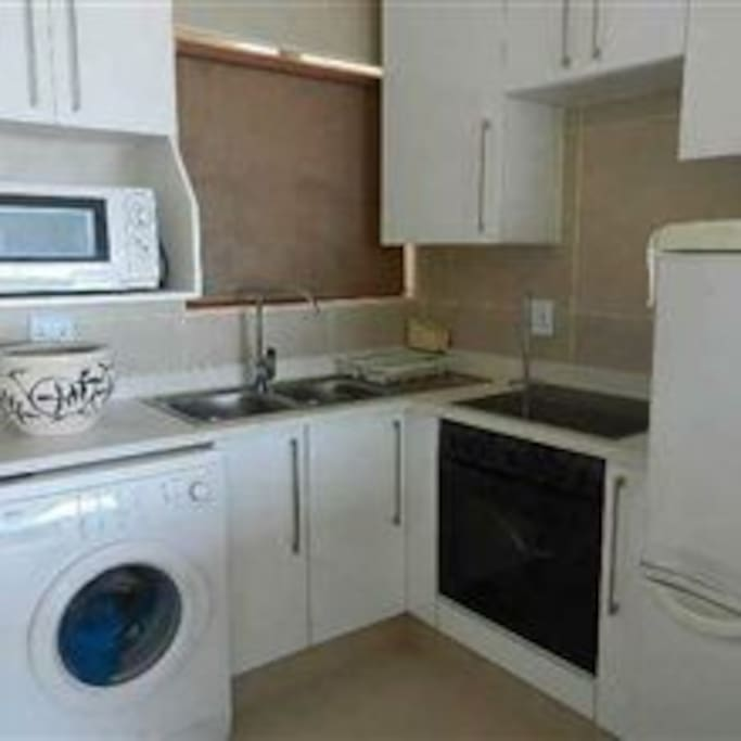 Equipped modern kitchen with washing machine
