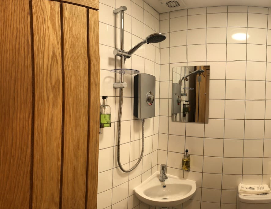 An ensuite shower, lavatory and  sink for your convenience