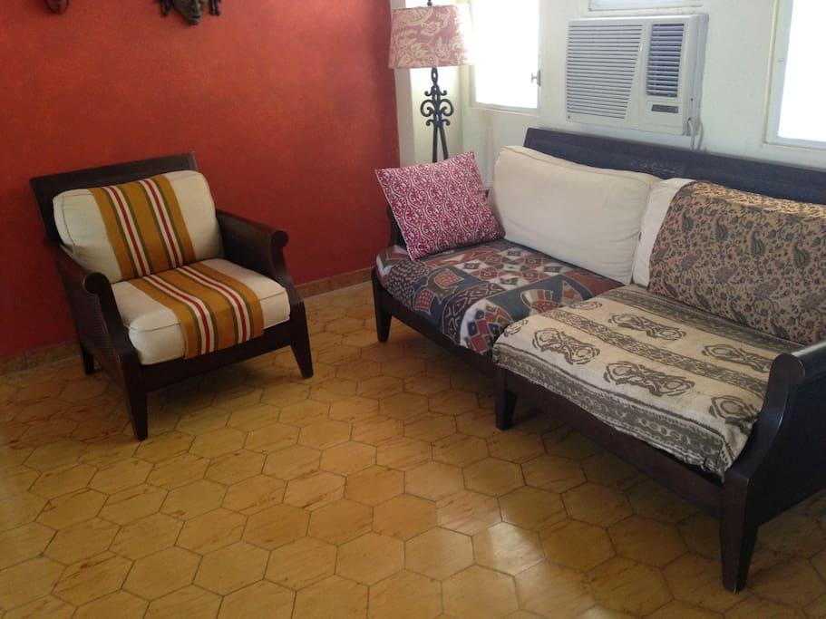 "Sofa & Chair. Original floor tiles ""lozas criollas"" dating from the 1930's."