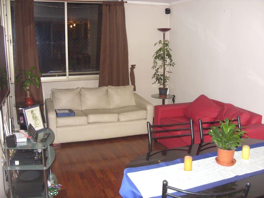 Living con sofa de 3 cuerpos y otro de 2 cuerpos