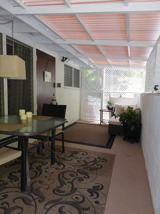 Your private, covered lanai for relaxing and a full size table for eating.