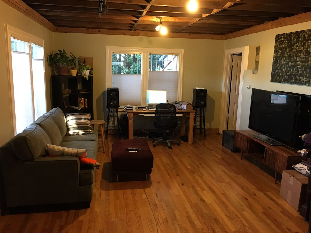 """living room with 60"""" TV."""