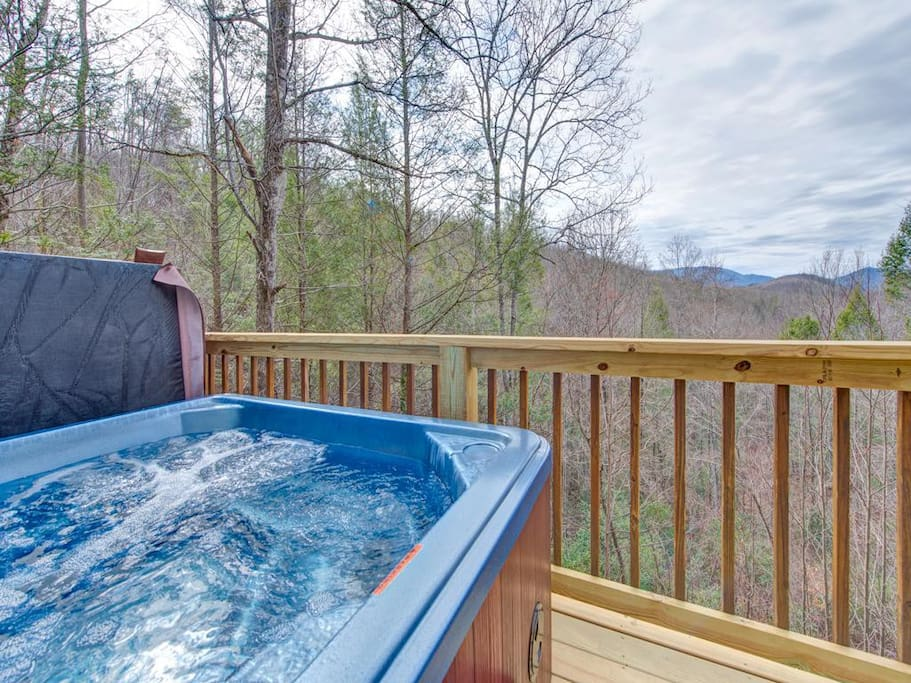 The perfect end to a perfect day - Before calling it a night, step into the spacious hot tub on the back deck and revel in the st