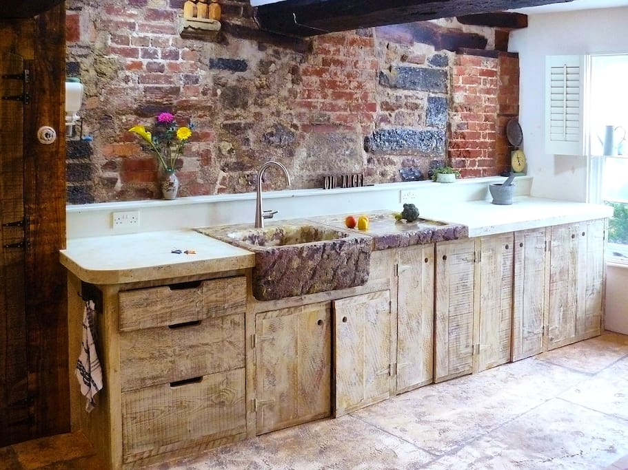 Hand built kitchen. Ancient wall